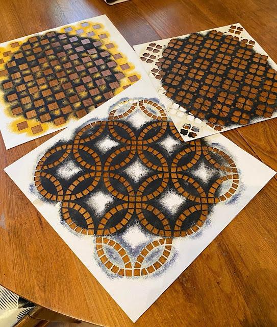 Photo of three paper pattern stencils