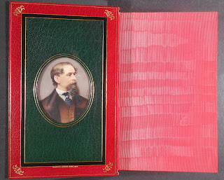 Portrait of old Dickens with sil end papers shown