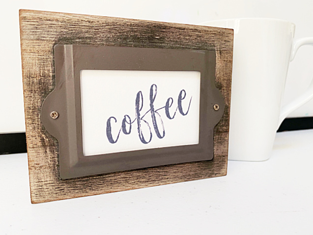 wooden coffee sign and a cup