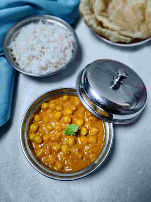 Serving chole with rice and puri for chole recipe