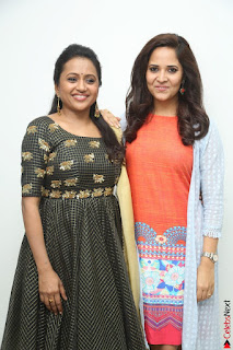 Actress Suma in Black Salwar Suit and Anusuya in orange Dress at winner movie press meet part 1 February 2017 (53).JPG
