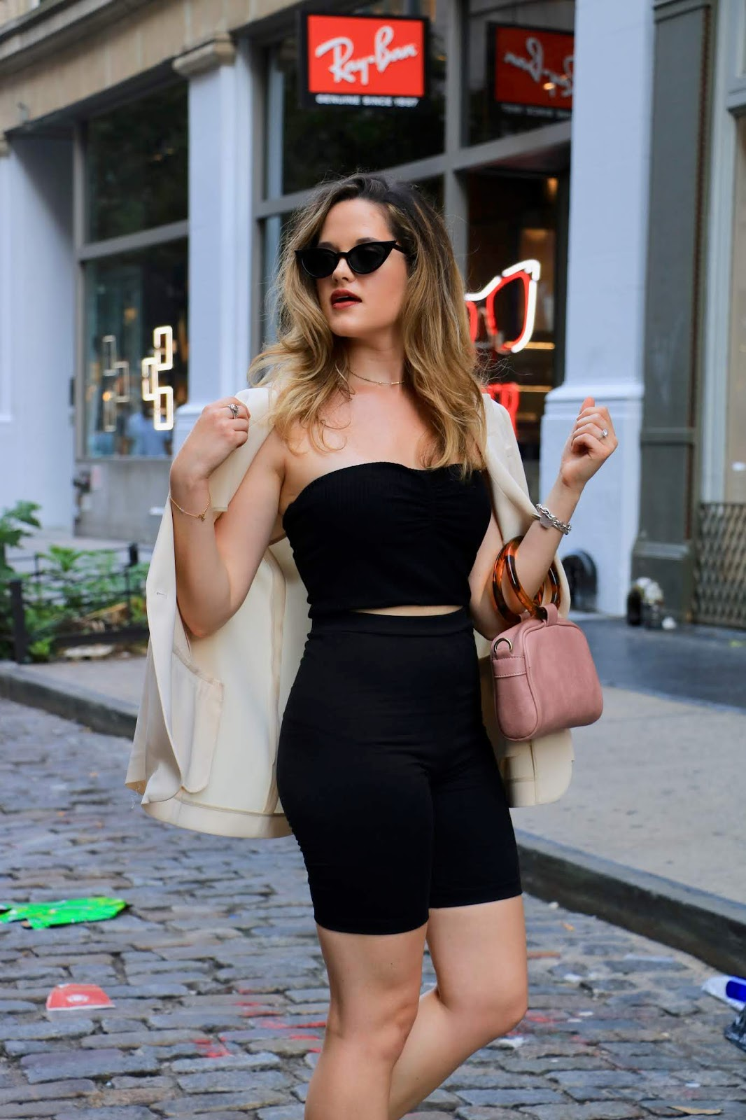 Nyc fashion blogger Kathleen Harper showing a chic way to wear bike shorts.