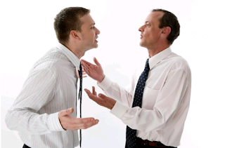 two white men on white long sleeves and a tie arguing