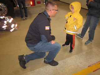 Kid talking to a firefighter