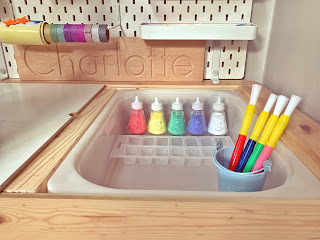 powder paints in salt pots on ikea flisat table with skadis pegboard
