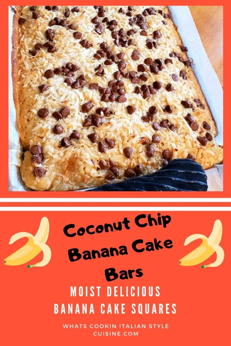 this is a pan of banana cake topped with coconut and chocolate chips in a sheet pan lined with parchment paper there are bananas in the background and pot holder on the pan