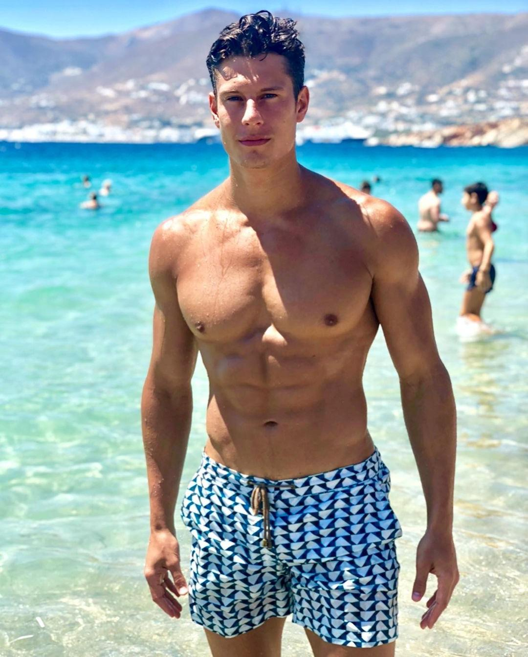 shirtless-fit-male-model-massive-muscular-pecs-abs-blue-ocean-summer-fun-young-hunk