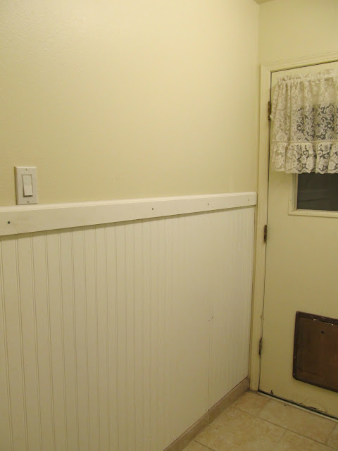 Laundry room makeover before