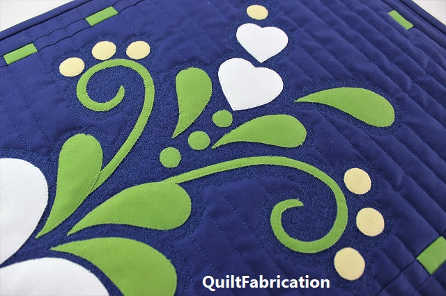 Spring Fling table runner stipple quilting by QuiltFabrication