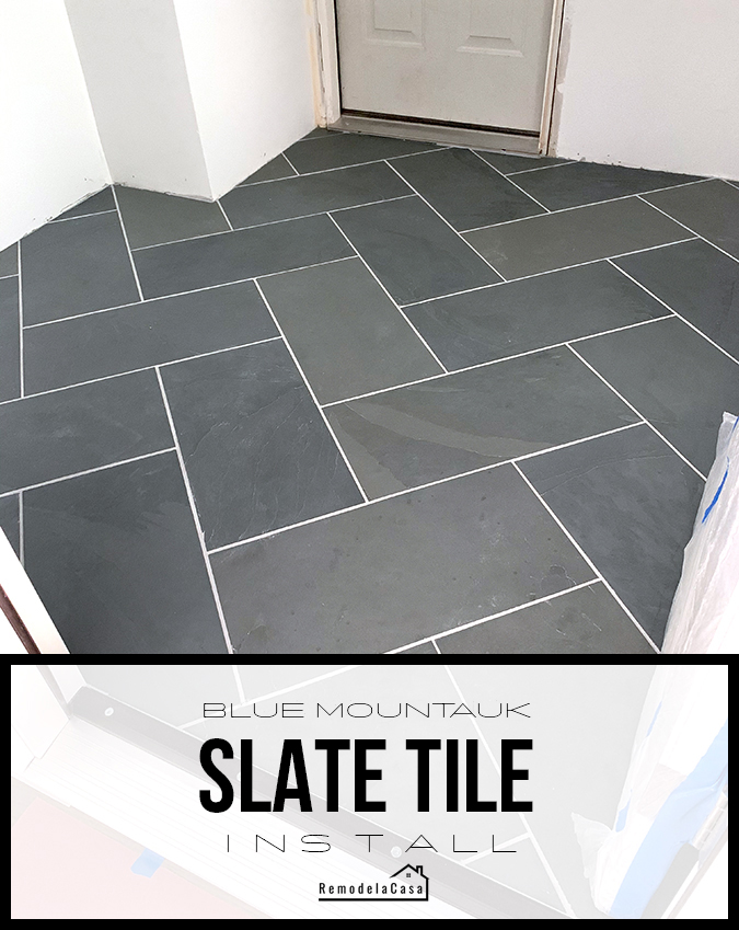mudroom with herringbone slate tile with light grout