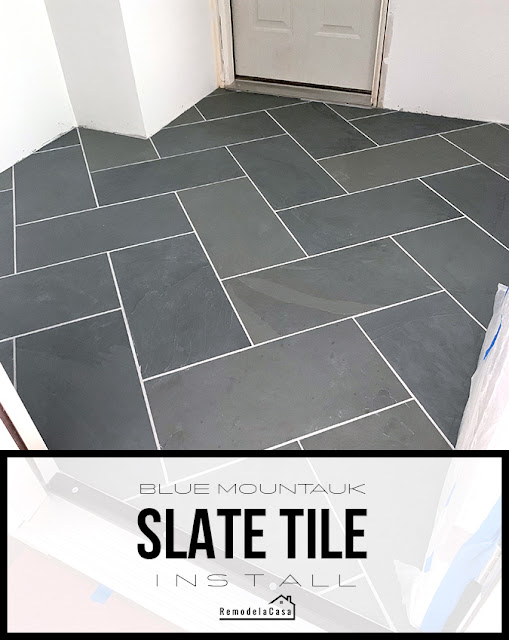 mudroom with slate tile flooring