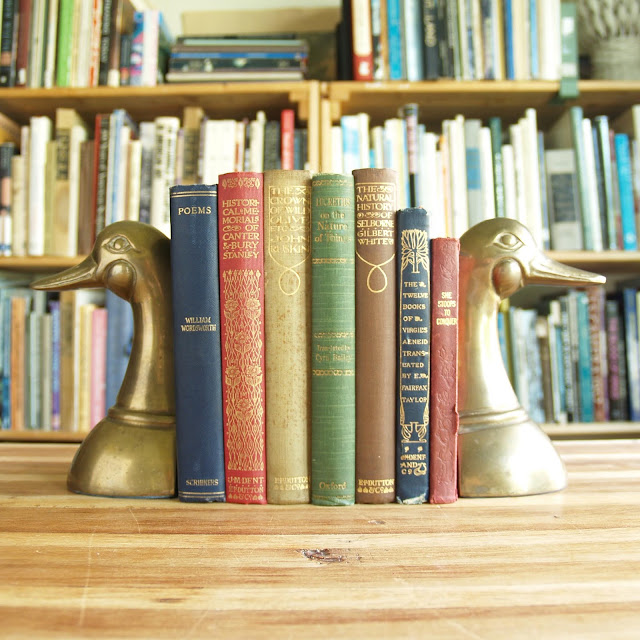 Friday giveaway: seven antique books in multicolored bindings