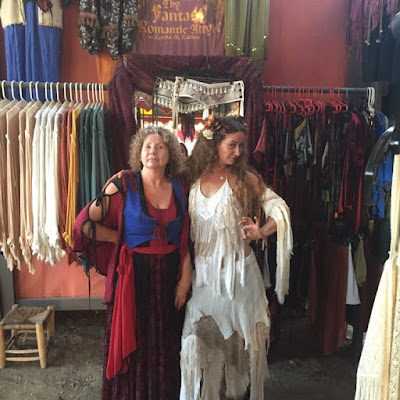Two women wearing fantasy renaissance clothing