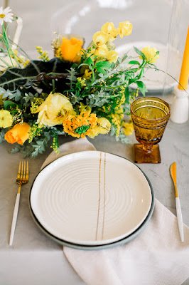 white and yellow reception place setting