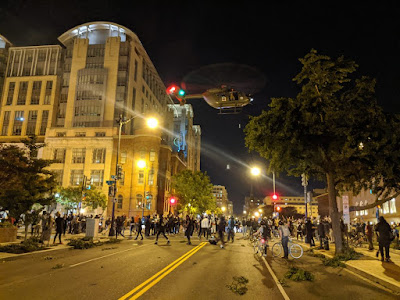 photo of helicopter flying low over protesters in DC