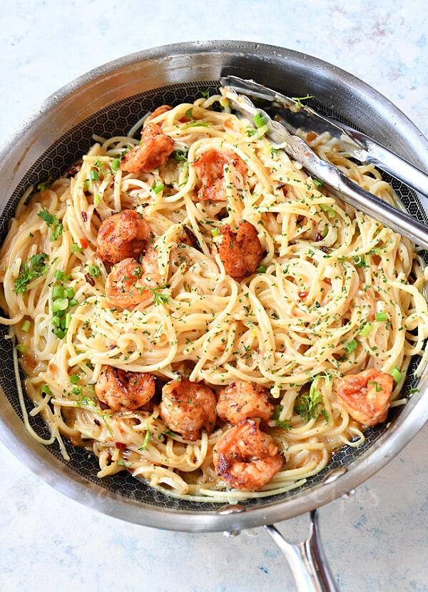 a pan with bang bang shrimp pasta