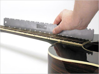 image a nothched straight edge on a guitar neck