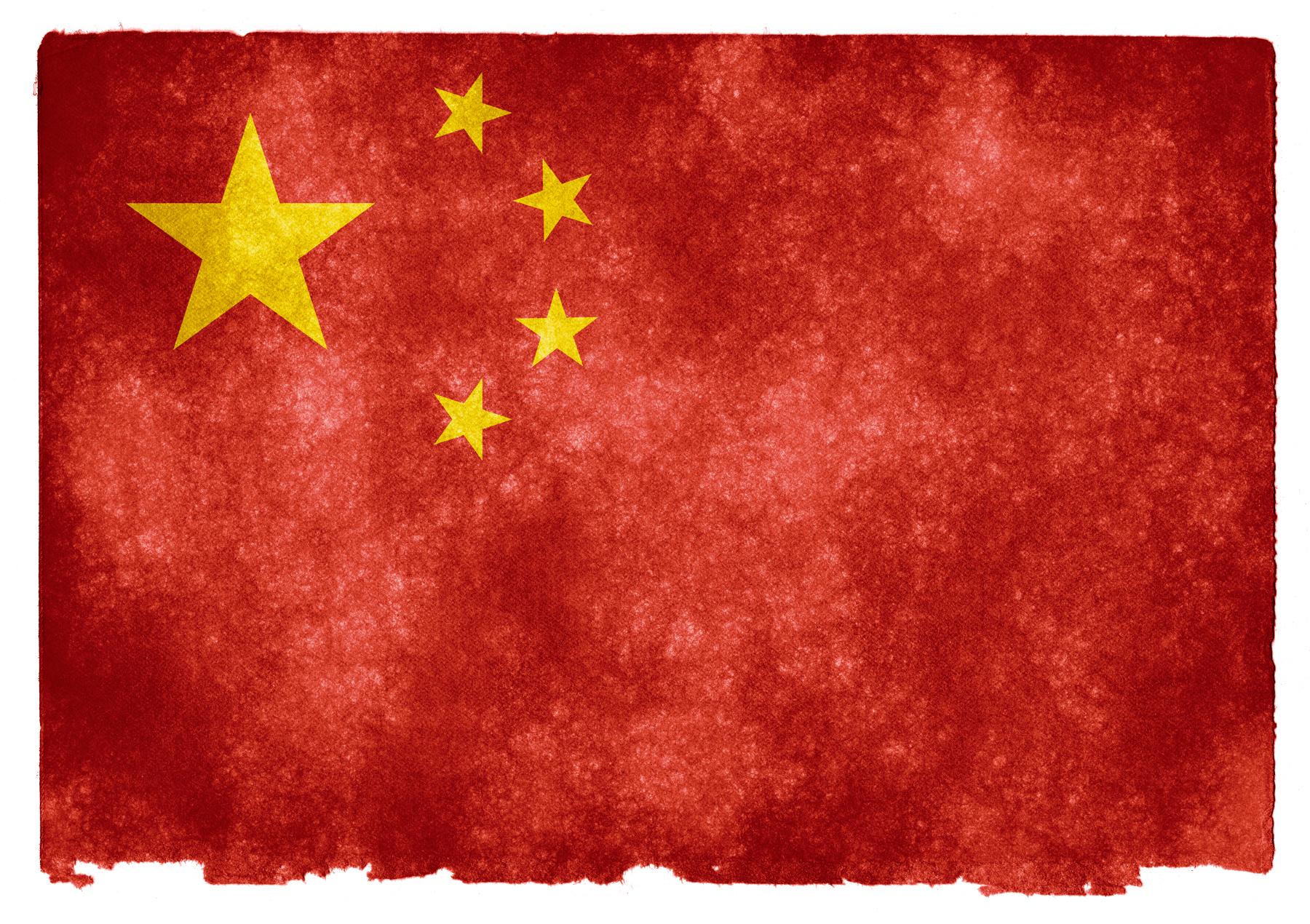 Bandeira chinesa estilizada, com as cinco estrelas em amarelo e o fundo em vermelho texturizado