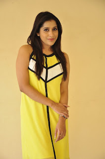 Rashmi Gautam in a Sleevless Short Yellow Dress at Guntur Talkies Movie Press Meet