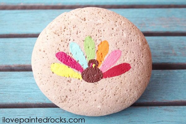 how to paint an easy turkey painted rock with colorful tail feathers.