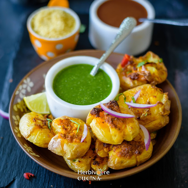 Air Fried Masala Smashed Potatoes in a plate with cilantro chutney