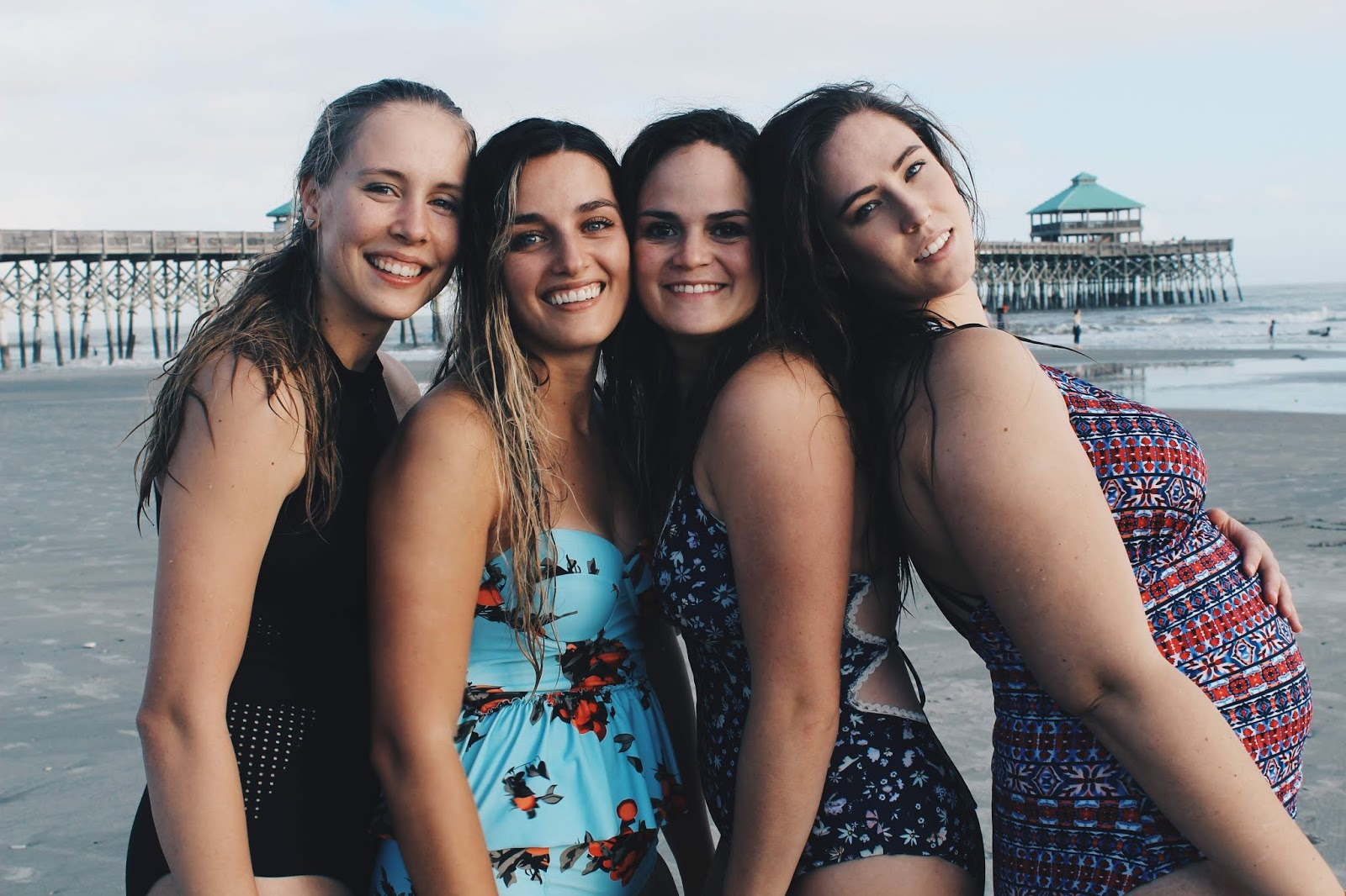 Four friends at Folly Beach in South Carolina