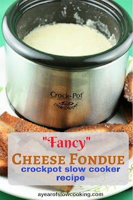 """Fancy Cheese fondue in the Little Dipper crockpot slow cooker is a delicious and """"grown up"""" snack. There's no velveeta here!! :-0"""