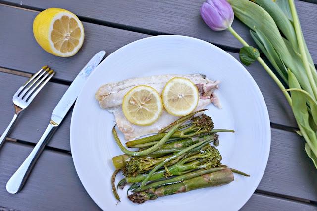 fresh fish, lemon and asparagus