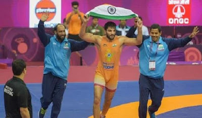 sunil kumar running after winning gold medal in asian wrestling championship