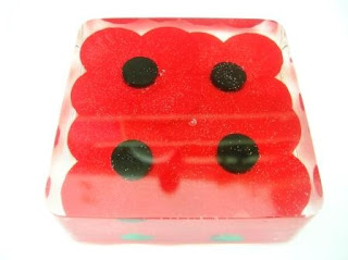 Remembrance Day Poppies within a paperweight