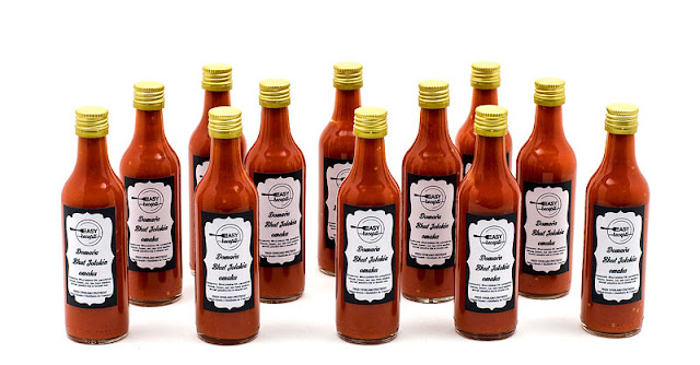 Homemade chilli sauce bhut jolokia with labels