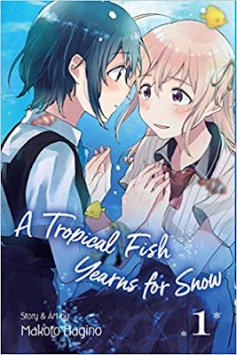 two teen girls hold hands, gaze into each others eyes, surrounded by a field of water and fish as though they were in or near an aquarium