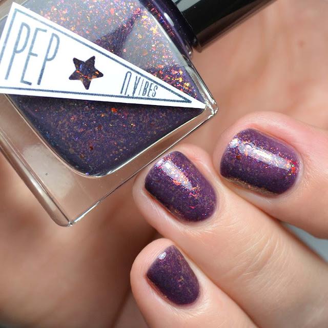 wine crelly nail polish with color shifting flakies