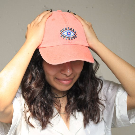 Peach evil eye patch baseball cap modelled and made by Wildflower and Company