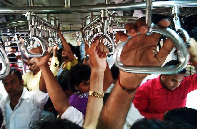 men's compartment in crowded local