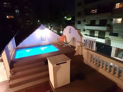 Swimming pool on roof terrace with lighting