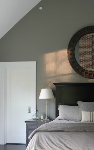 Grey and black masculine decor in a modern farmhouse bedroom - Hello Lovely Studio