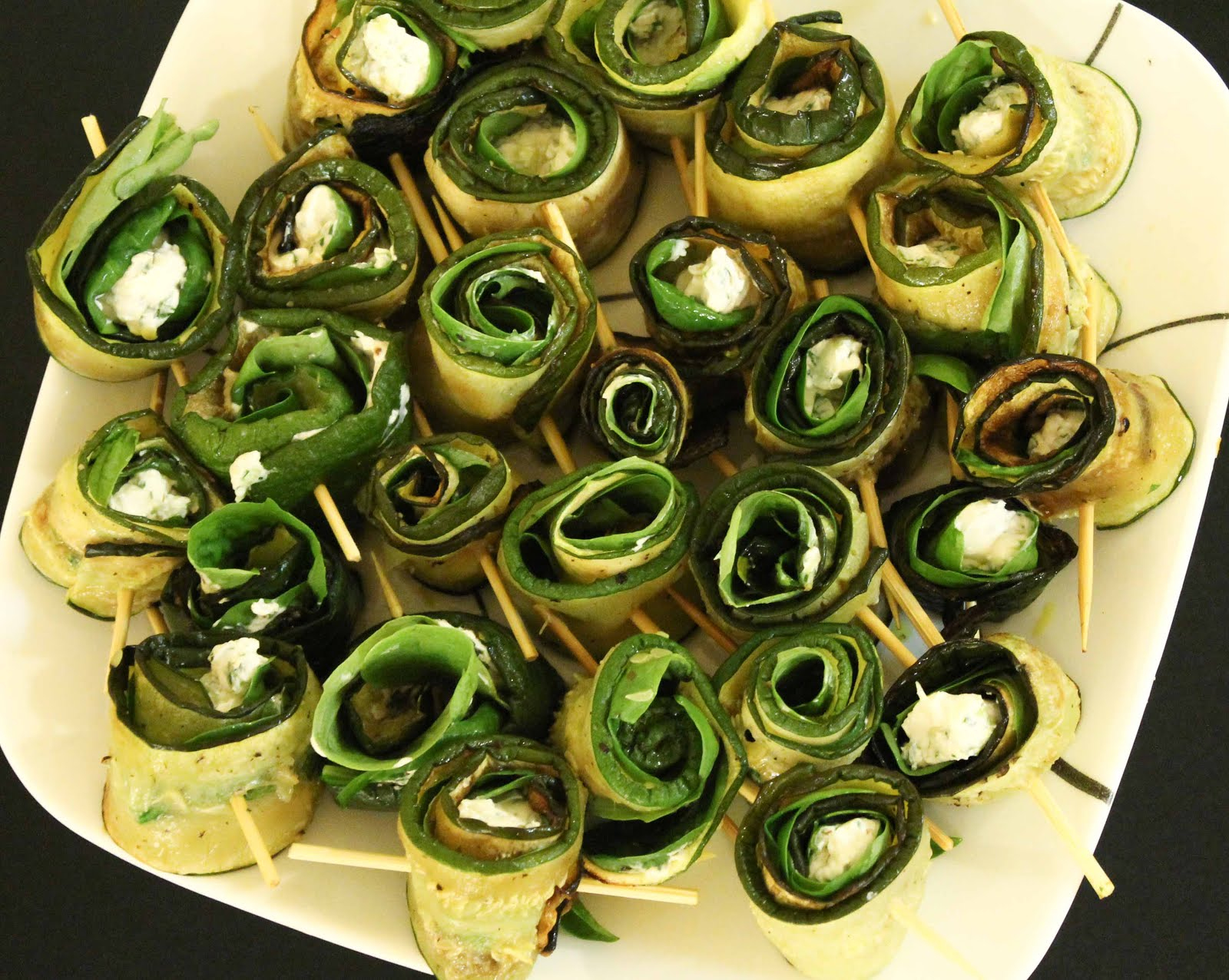 Mr Green zucchini, basil, spinach, garden herbs and cream cheese roll-ups.