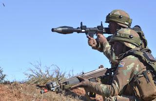 a south african soldier firing an rpg-7