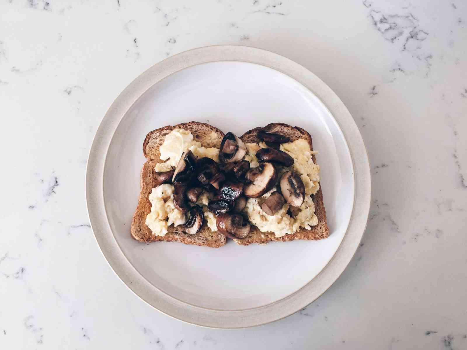 Scrambled egg and mushroom on toast