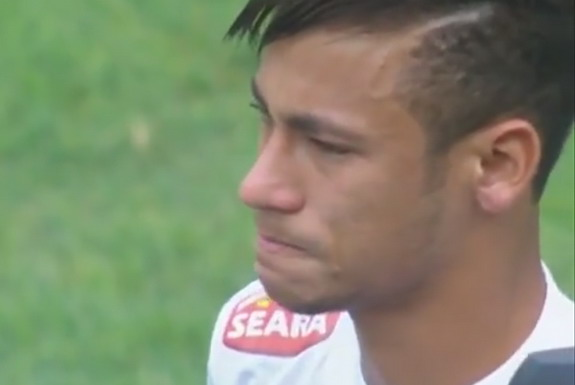 Neymar is seen crying during the national anthem prior Santos' game against Flamengo