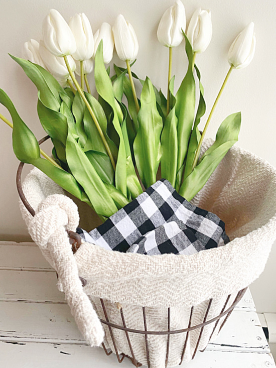 long stemmed white tulips in a lined clam basket