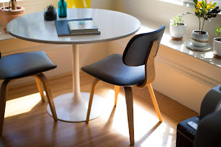 dining area, dining, black chair, round table
