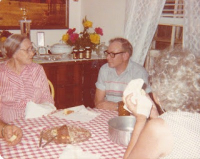 Photo of grandma, daddy, and Aunt Inez sitting at table talking