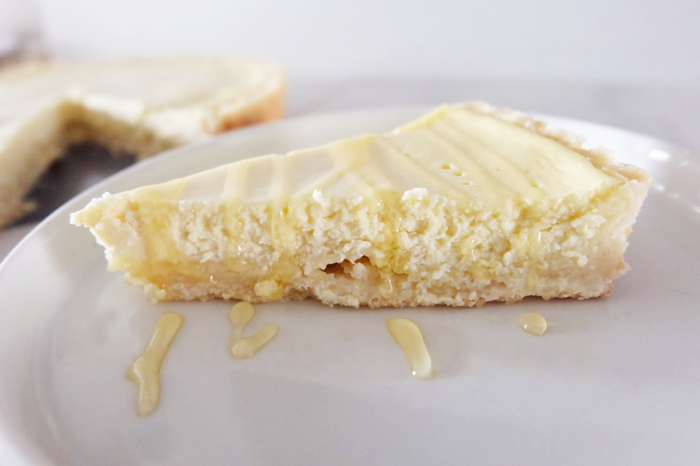 side view of sliced Greek yogurt cheesecake tart
