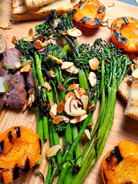 Grilled Honey Ginger Glazed Pork Tenderloin with Apricots & Broccolini:  Juicy pork tenderloin is spiced just right and then glazed with a ginger honey scallion sauce and served with grilled apricots and broccolini with toasted almonds. - Slice of Southern