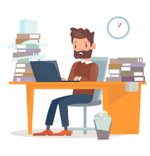 Overworked man sitting at computer time tracking