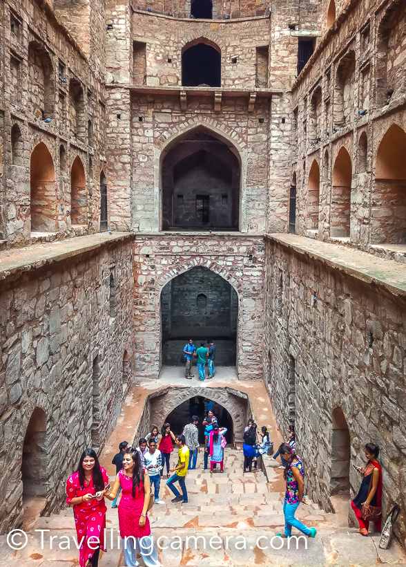 When loitering around in Cannaught Place or navigating traffic on Barakhamba Road, it is difficult imagine that barely 5-minutes away, hidden amongst trees, lies the magnificient stone structure of Agrasen ki baoli. The 14th-century step well was restored by the Archaeological Survey of India in the year 2002. Now the Baoli is clean and well-maintained. We visited Agrasen ki Baoli on a humid Sunday afternoon and were expecting to find a more or less abandoned structure with may be a couple of people loitering about here and there. But we were in for a surprise. The baoli was buzzing with well-dressed, pouting, selfie-clicking youngsters. They were there in such large numbers that it was difficult to capture even a single shot without people in it. This was heartening. I don't know whether this popularity is because the Baoli was recently featured in the popular Bollywood film PK or because the Baoli is clean, litter-free and situated barely a kilometre away from the heart of the city. It may be all of these, but it is wonderful to see the hard work of the ASI bearing fruit. Usually when we head out to explore the city, we make sure that we carry a DSLR and all the required lenses, but this time we had decided to do something different. The impact of camera phones on the photography ecosystem is the hot topic for debate nowadays, and we decided to settle it with a practical. So this time instead of a DSLR, we were carrying a smartphone - Honor 5c to be precise. All the pictures that you are seeing in this post have been clicked using Honor 5c. Based on the results, we can comfortably say that for everyday non-professional use, a smartphone, if used well, can suffice. One would of course need to study all the capabilities and features of the particular smartphone camera in details to be able to use them in appropriate situations. Coming back to the Baoli, we captured the structure, the pigeons peeping out of the gaps in the walls, the contrast between the modern skyscrapers of CP and the medieval architecture of the Baoli, the people exploring the structure and a lot more. The baoli is situated in one of the lanes branching out of the very pretty Hailey road, and this lane is dotted with some very interesting grafitti. We captured some of that too. If you haven't yet seen Agrasen ki Baoli, we recommend that you should. But make sure that the day is pleasant and you have time on your hands, because there is a lot to take in at the Baoli and in the surroundings.