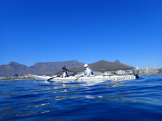 Kayaking against the backdrop of Table Mountain