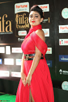 Apoorva in a Stunning Tight Leg Split Sleeveless Red Gown at IIFA Utsavam Awards 022.JPG
